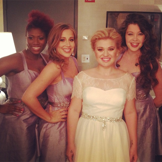 Kelly Clarkson and her back up singers wearing Watters Bridal Design.