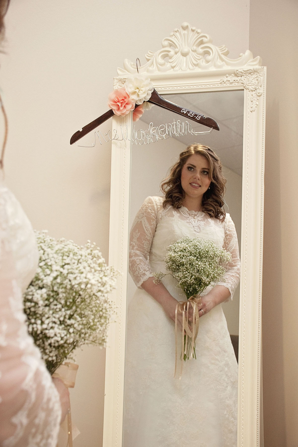 Gorgeous plus size bride wearing a sleeved A line dress