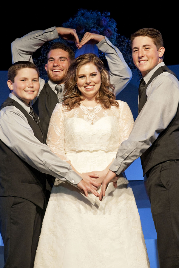 "Gorgeous plus size bride with her brothers, her ""bridesmaids"""