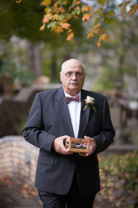 Grandmother as a ring bearer in this a fall garden wedding with a brunch reception