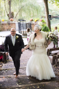 Gorgeous plus size bride in a fall garden wedding with a brunch reception