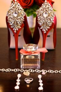 red shoes, red badgley mischka, tiffany bracelet, engagement ring, tear drop chandelier earrings