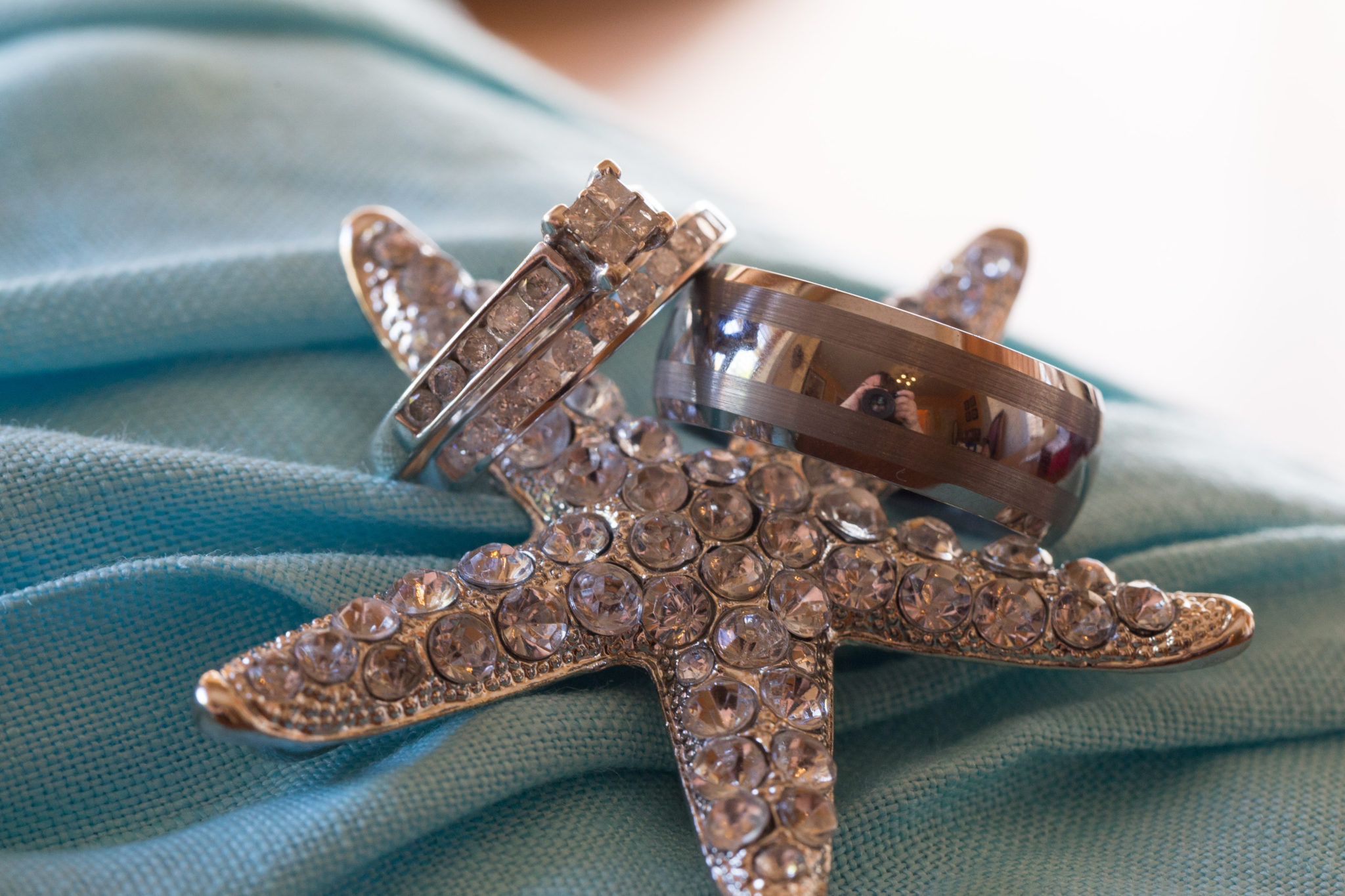 jeweled star fish with wedding bands and wedding ring