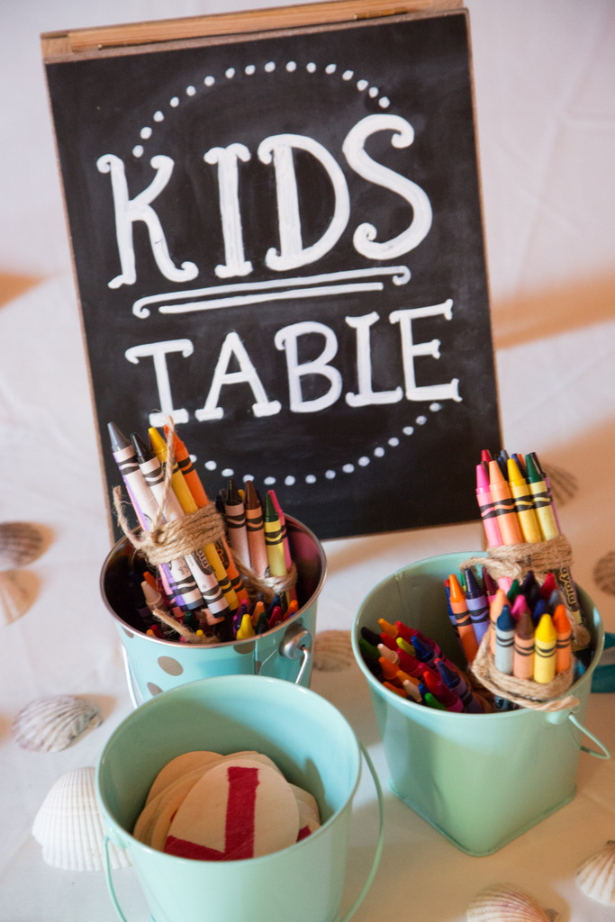 nautical diy table centerpiece, bouquet, starfish, kid table, chalkboar sign, crayons candy