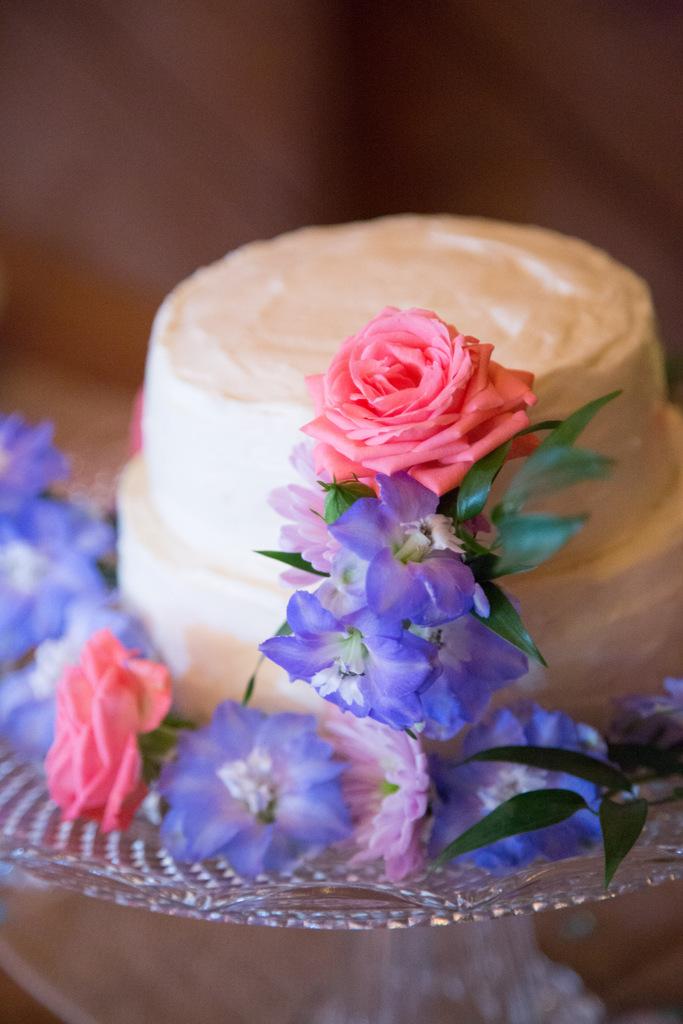 wedding cake, pink and purple flowers