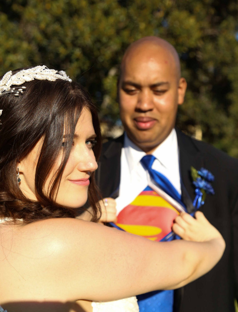 plus size bride with groom in his superman tshirt