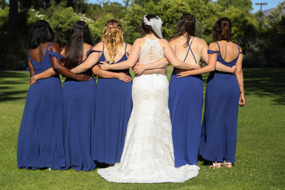 plus size bride with bridal party
