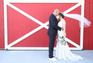 plus size bride with groom with her heirloom veil