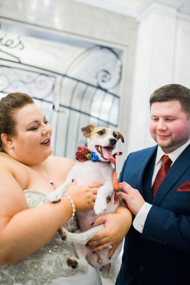 plus size bride and groom with dog wearing a flower collar