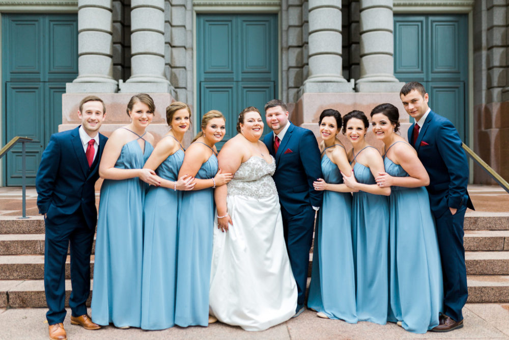 plus size bride and groom with wedding party wearing slate blue and navy