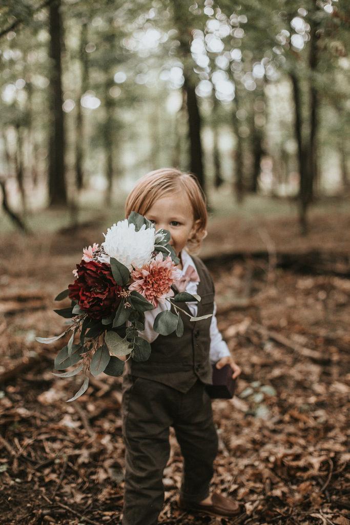 child holding wedding bouquet